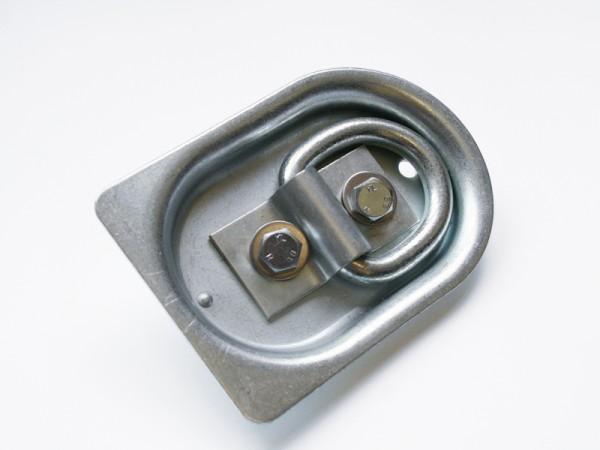 4 St. Anbinderinge versenkt in Holzboden, Zugkraft je 0,4 t. Die Ringe dürfen nur über den Querträgern montiert werden